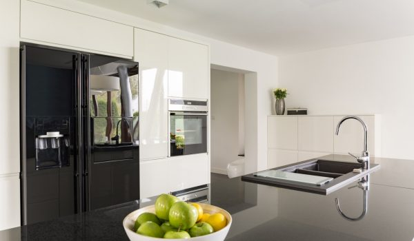 Elegance in kitchen interior with fridge and marble worktop